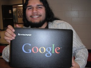 Picture of me, with the laptop with google on the front cover